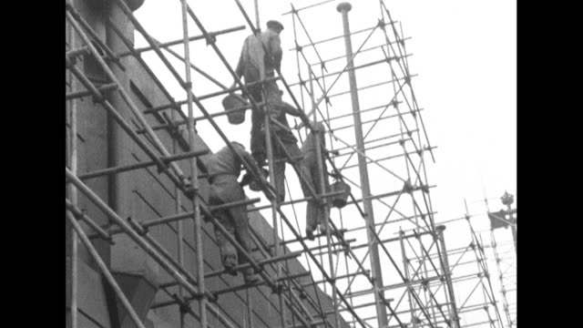 sequence showing workmen cleaning the exterior of wembley stadium. - 1950 1959 stock videos & royalty-free footage