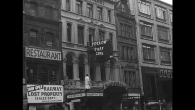 sequence showing workmen putting up signage for follow that girl at the vaudeville theatre london - theater marquee commercial sign stock videos & royalty-free footage