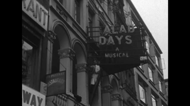sequence showing workmen removing the signs for salad days at london's vaudeville theatre - theater marquee commercial sign stock videos & royalty-free footage