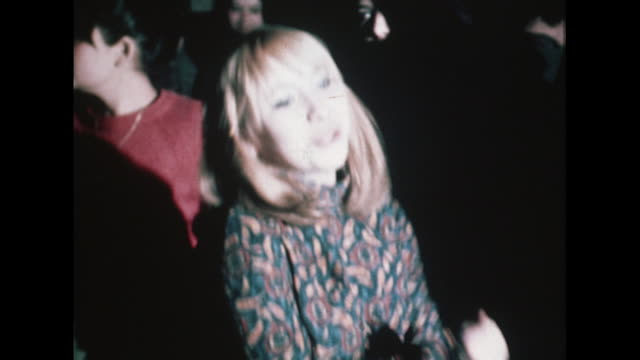 sequence showing young people dancing in a nightclub in praque - bbc archive stock-videos und b-roll-filmmaterial