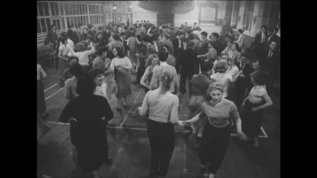 sequence showing young people dancing to rock and roll music - klassischer rock and roll stock-videos und b-roll-filmmaterial