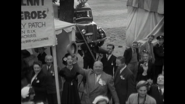 sequence travelling through a theatrical charity garden party held at the royal chelsea hospital. - thora hird stock videos & royalty-free footage