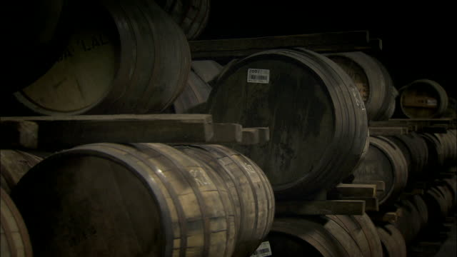 sequence whisky barrels in cellar - repetition stock videos & royalty-free footage