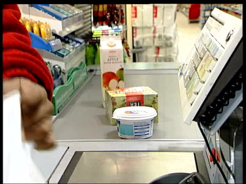 int sequence woman customer paying for goods at supermarket with chip and pin card - cards stock videos & royalty-free footage