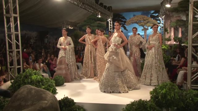 sequined and sparkling bridal wear dominates the runway at the final day of pakistan fashion week in karachi - catwalk stock videos & royalty-free footage