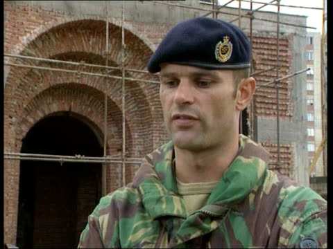 serb cathedral attacked itn cathedral with scaffolding around damage to wall caused by explosion soldiers searching for clues to explosion soldiers... - sergeant stock videos and b-roll footage