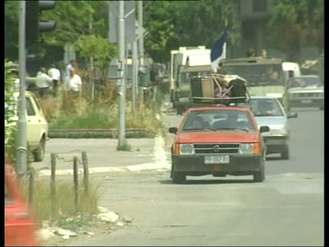 serbia kosovo pristina people to and fro on the streets crate of milk carried serb soldiers on the street and along serb soldier embracing woman serb... - serbia stock videos & royalty-free footage