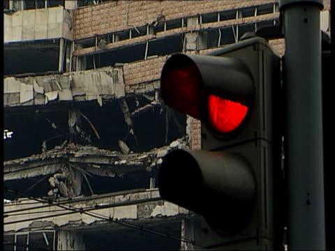 serbia: belgrade: ext gv wreckage of building destroyed during war traffic lights as wreckage in b/g fade to - slobodan milosevic stock-videos und b-roll-filmmaterial