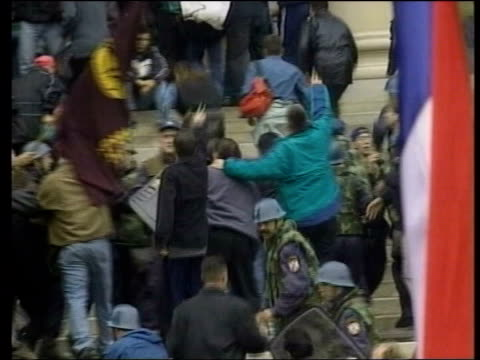 serbia belgrade october 2000 ext crowds storming serb parliament march 2001 security forces at house of slobodan milosevic during his arrest - serbia stock videos & royalty-free footage