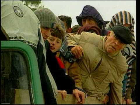 Kosovo NATO Action/Diplomacy/War Crimes LIB Albanian refugees on lorry Refugee vox pops SOT