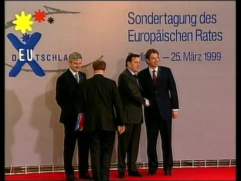 air attacks begin; germany: berlin: int chancellor gerhard schroeder standing talking with others including foreign minister joschka fischer ext... - lionel blair stock videos & royalty-free footage
