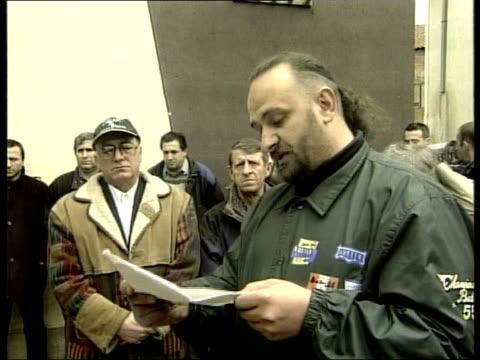 stockvideo's en b-roll-footage met kosovo nato air attacks begin serbia kosovo nato air attacks begin itn people buying potatoes sacks of potatoes wheeled away shuttered shops pan... - kosovo