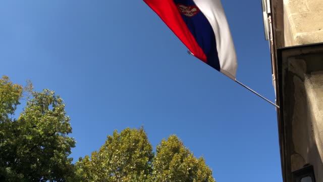 stockvideo's en b-roll-footage met servische vlag zwaaiende langzaam - arts culture and entertainment