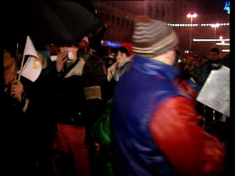 serbian people protesting against state media bang pots and pans and blow whistles outside radio station building belgrade; 1997 - serbia stock videos & royalty-free footage