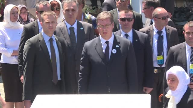serbian premier aleksandar vucic was forced to flee a srebrenica memorial ceremony saturday when an angry crowd threw stones at him at a 20th... - yugoslav wars stock videos & royalty-free footage