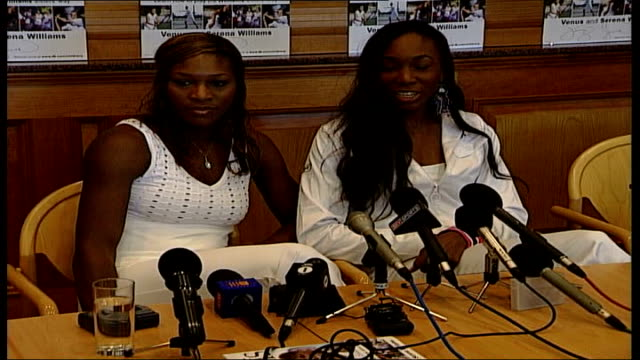 stockvideo's en b-roll-footage met serena williams and venus williams book launch / interview / photocall england london wimbledon int cms 'how to play tennis' book by tennis players... - new not politics