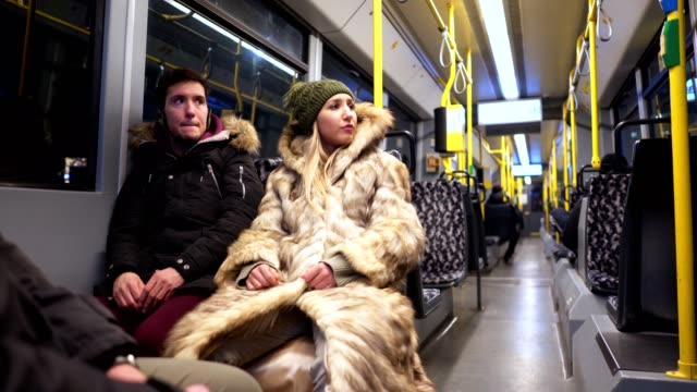 vídeos de stock e filmes b-roll de serene couple traveling together with a bus - autocarro elétrico
