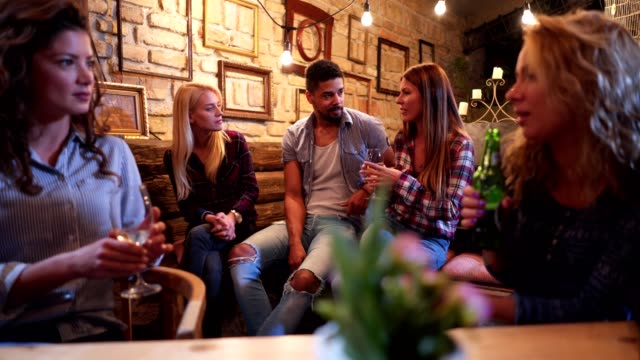serene people enjoying their time talking at a bar - social gathering stock videos and b-roll footage