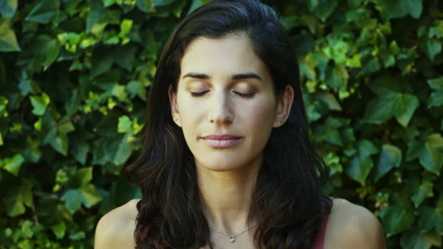 serene spanish mid adult woman - eyes closed stock videos & royalty-free footage