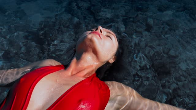serene woman floating on sea - lying on back stock videos & royalty-free footage