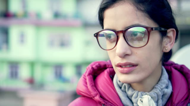 serene young woman thinks and looks at view. - reflection stock videos & royalty-free footage