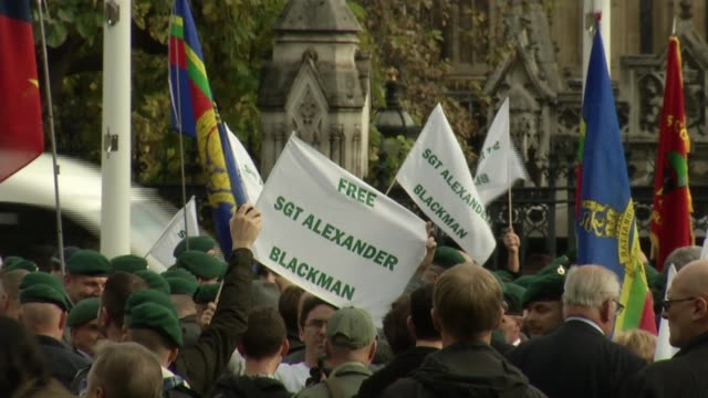 sergeant alexander blackman: military personnel defy orders to protest for jailed marine; england: london: westminster: ext various shots of... - sergeant stock videos & royalty-free footage