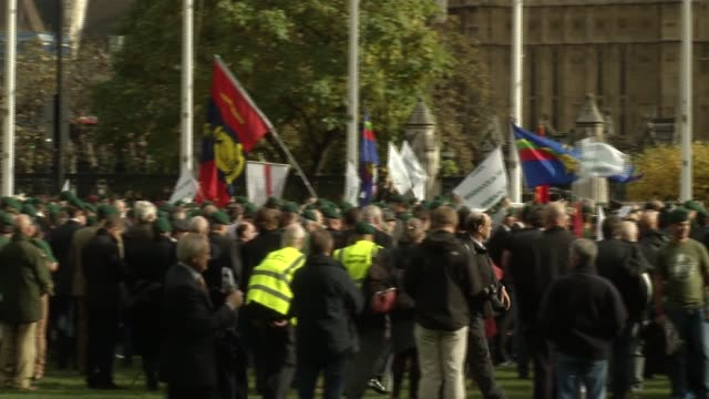 sergeant alexander blackman: military personnel defy orders to protest for jailed marine; england: london: westminster: ext long shot of protesters... - sergeant stock videos & royalty-free footage