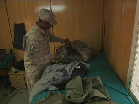 sergeant christopher reddick packing to go home at the end of the war in iraq. this shot taken at camp taji in iraq, a military installation used by... - sergeant stock videos & royalty-free footage