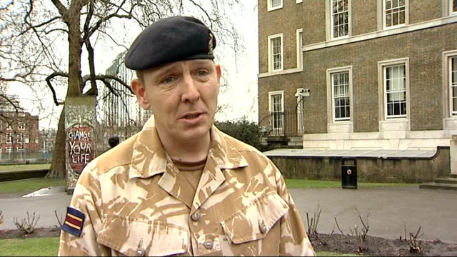 sergeant dave heyhoe interview sot reporter to camera as throws ball for treo - sergeant stock videos & royalty-free footage