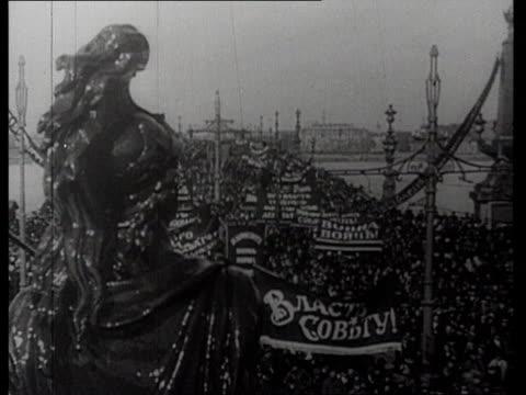 Sergei Eisenstein's reenactment film of Russian Revolution and demonstrations crowd running on street under fire / Russia