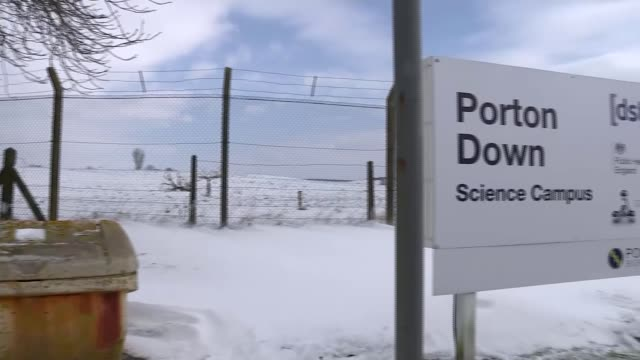 Boris Johnson accuses Russia of trying to hide 'the needle of truth' ENGLAND Wiltshire EXT Chain link fence and trees beyond salt bin and snow on...
