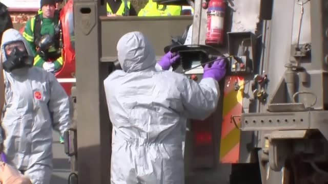 britain to expel 23 russian diplomats england dorset gillingham ext various of investigators in chemical protection suits hazmat suits loading... - sergei skripal stock videos and b-roll footage