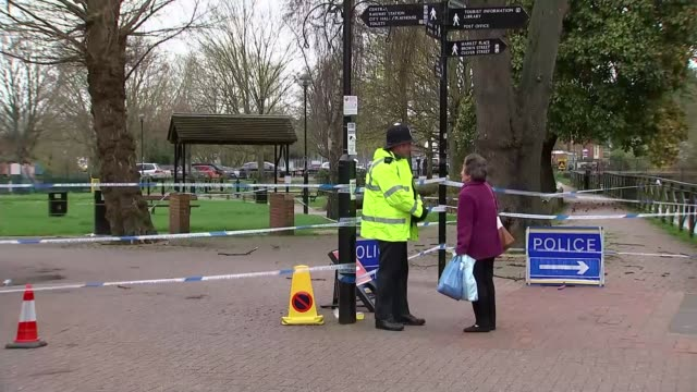 decontamination expected to take months salisbury police officer chatting to woman by cordon tape at crime scene in park - boundary stock videos & royalty-free footage