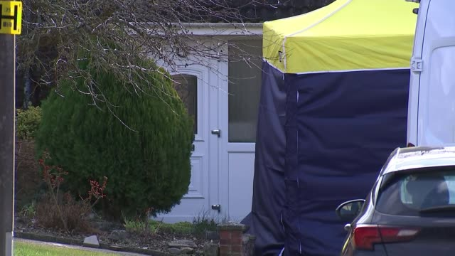 Decontamination expected to take months Christie Miller Road Police officers standing in front of Sergei Skripal's house Blue and yellow forensic...