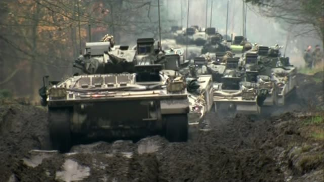 May warns Russia / Allies support the UK T21111427 / POLAND Zagan EXT Column of armoured vehicles along muddy track during NATO exercise Various of...