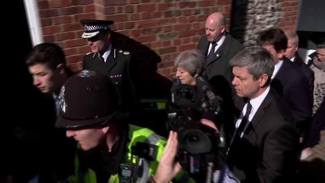 May warns Russia / Allies support the UK ENGLAND Wiltshire Salisbury EXT Theresa May MP along with police escort as heckled by local Theresa May...