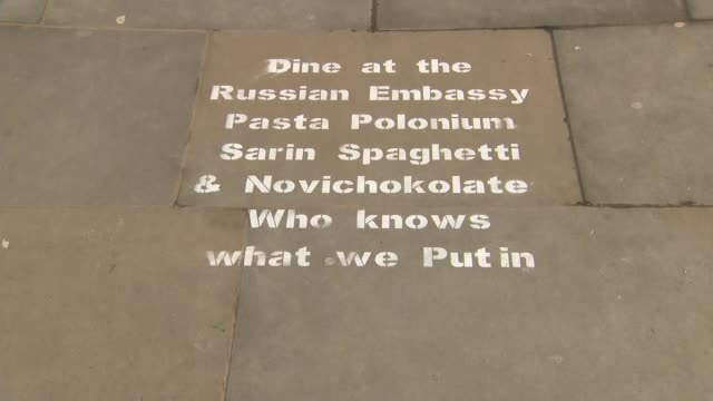 may warns russia graffiti outside the russian embassy england london ext van entering the grounds of the russian embassy / various of graffiti on... - sergei skripal stock videos and b-roll footage