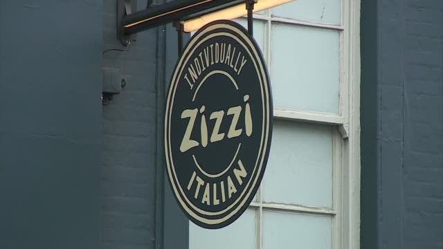 salisbury diners told to wash possessions ext focus hanging zizzi sign zizzi building tilt down barriers - sergei skripal stock videos and b-roll footage