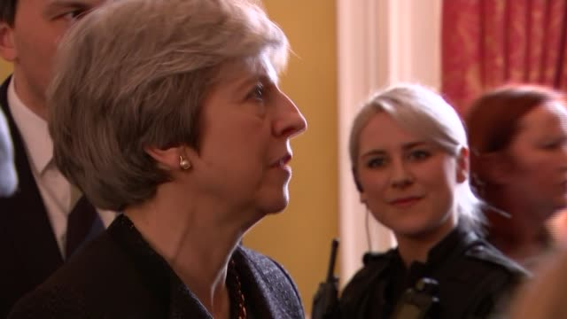 Theresa May walkabout in Salisbury INT Theresa May arriving at reception and along up stairs with Pritchard and Glen / various of May meeting and...