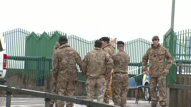 troops deployed to salisbury as investigation continues wiltshire salisbury ext military trucks along road soldier speaking to paramedic through... - fence stock videos & royalty-free footage