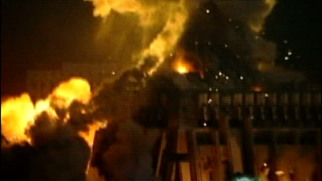 51 people killed file / march 2003 lib iraq baghdad buildings exploding into flames and smoke rising into air during 'shock and awe' bombing of... - allied forces stock videos and b-roll footage