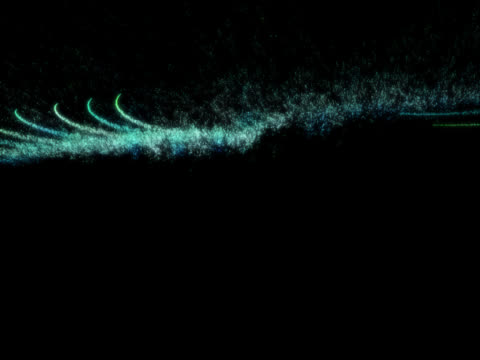 A series of green lines, reminiscent of jet fighter vapour trails, shoot around each against a black background.
