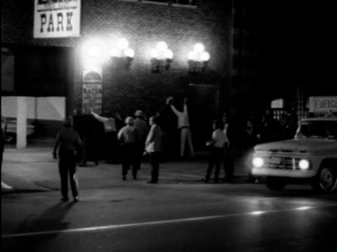 series of shots of demonstrations against vietnam war in streets of chicago during the democratic national convention night shots of police violently... - 1968 bildbanksvideor och videomaterial från bakom kulisserna