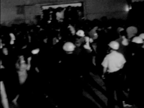 series of shots of demonstrations against vietnam war in streets of chicago during the democratic national convention night shots of police violently... - 1968年点の映像素材/bロール