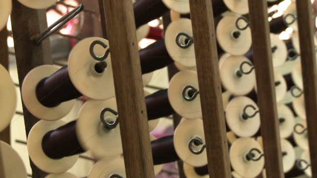 a series of spinning thread spools and eye hooks - ball of wool stock videos & royalty-free footage
