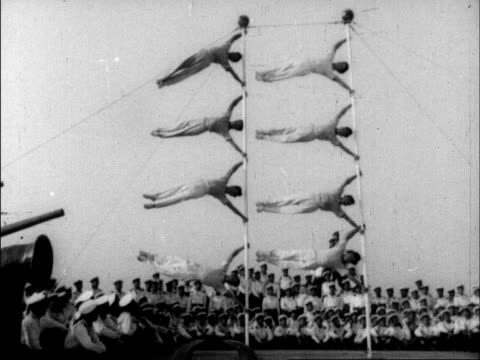 vidéos et rushes de a series of various acrobats perform wildly different routines for chinese audiences - marinière