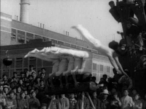 a series of various acrobats perform wildly different routines for chinese audiences - akrobat bildbanksvideor och videomaterial från bakom kulisserna
