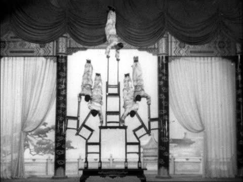 a series of various acrobats perform wildly different routines for chinese audiences - balans bildbanksvideor och videomaterial från bakom kulisserna
