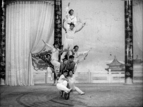 a series of various acrobats perform wildly different routines for chinese audiences - human pyramid stock videos and b-roll footage