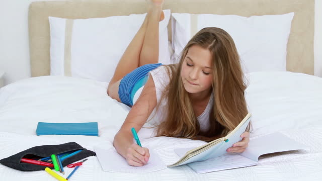 serious brunette woman writing a text - legs crossed at ankle stock videos and b-roll footage